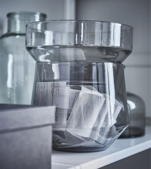 Create a modern home workspace in your living room without hiding every boring office thing away. Just put your receipts in a beautiful vase, such as IKEA PS 2017 transparent glass vase in grey. The set of three can also be stacked for storage.