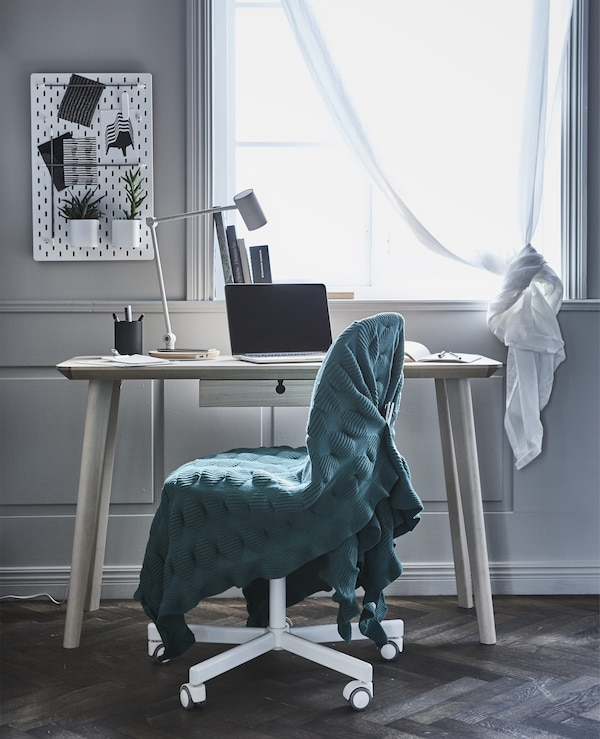 Create a work spot in your living room that doesn't scream office. Cover a desk chair in a blanket or comfy throw, and it will blend in with the rest of the furniture. IKEA offers a wide selection of desk chairs such as ÖRFJÄLL/SPORREN swivel chair.