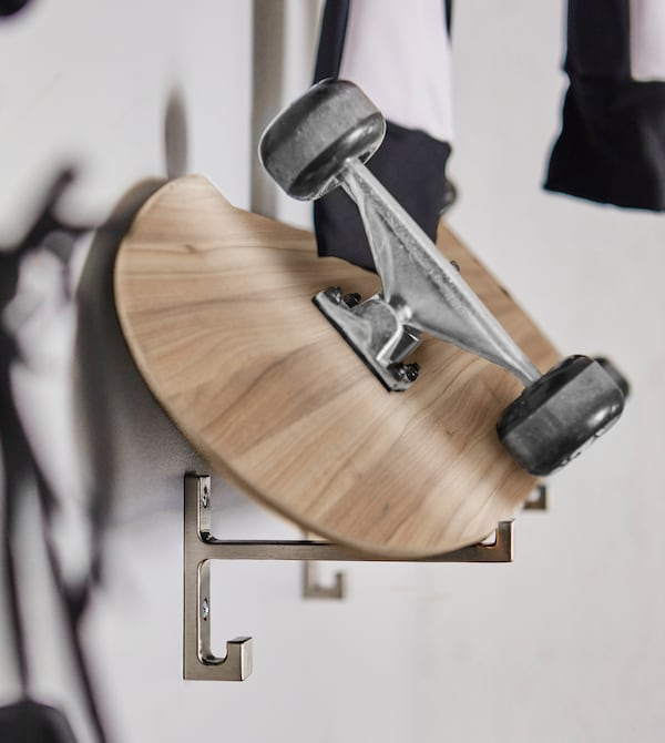 Create storage for your skateboards by resting it on two hooks.