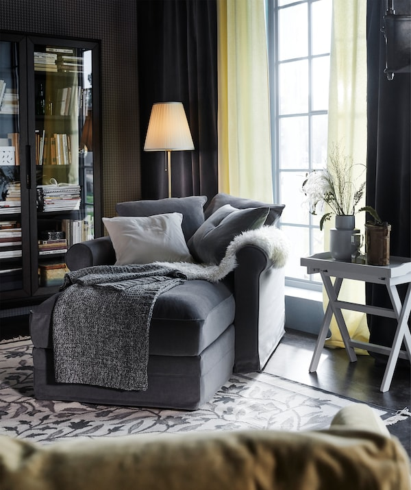 Curl up in a GRÖNLID chaise longue with a Tallmyra medium grey cover and cushions to place where you want them.