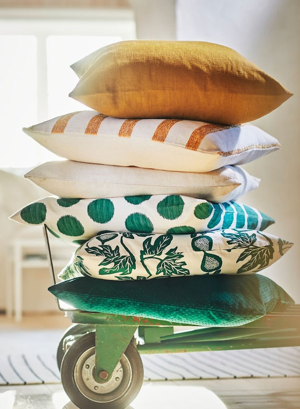 Cushions stacked on rolling cart