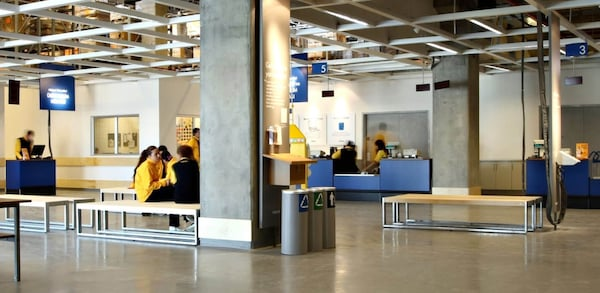 customers waiting at the ikea-returns department with tables