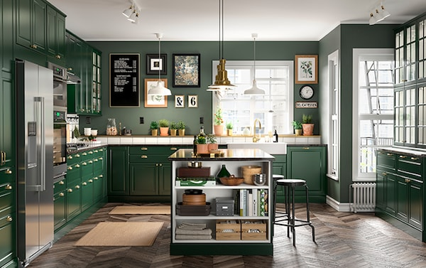 A large kitchen with green cabinets