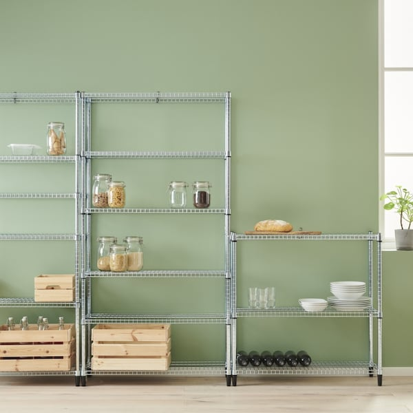 Metal shelving unit in a kitchen with jars and bottles