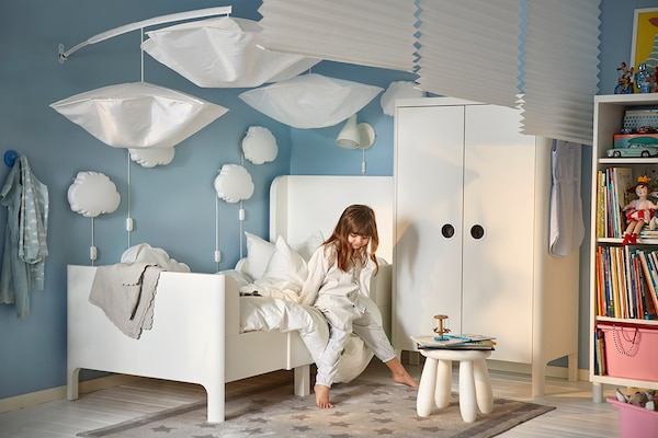 Little girl's bedroom with IKEA BUSUNGE extendable bed and wardrobe.