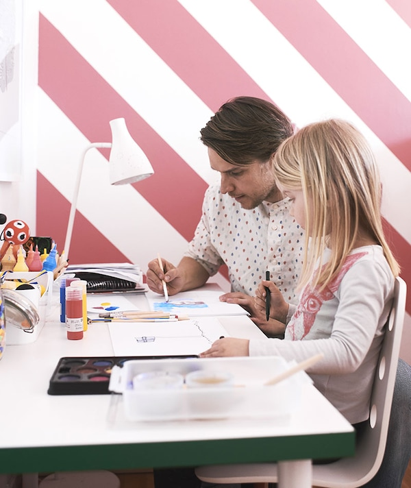 Dad and daughter behind a desk