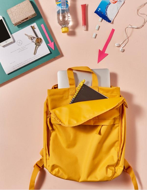 Das Wichtigste für die Uni, verpackt in STARTTID Rucksack in Gelb