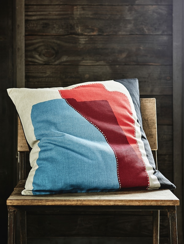A HANTVERK multicolour cushion cover, handmade in India.