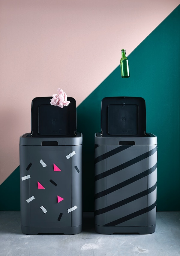 Decorated black dustbins for recycling.
