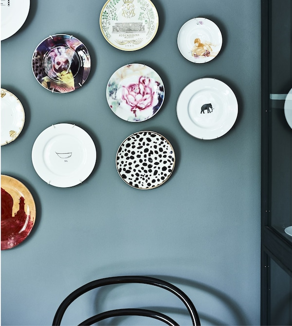 Decorative plates hung on a wall.