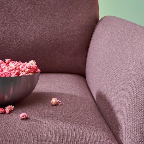 Dettaglio della poltrona reclinabile EKOLSUND con fodera asportabile e lavabile in marrone chiaro-rosa - IKEA