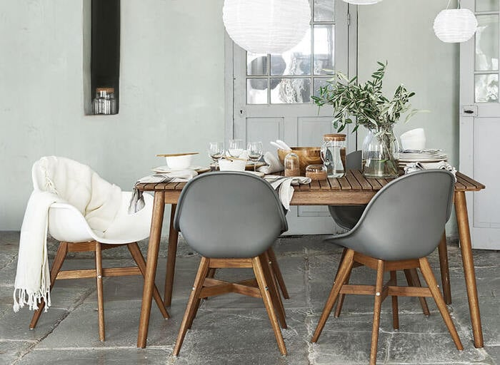Dining furniture featured in a light and airy setting