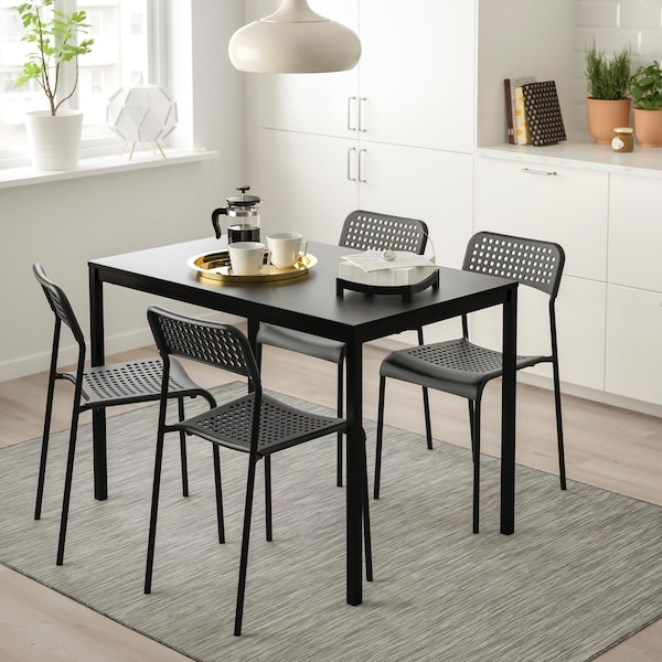Dining room setting including TÄRENDÖ table with ADDE chairs