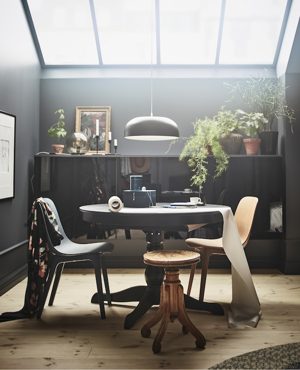 Dining room table and chairs with a pendant light overhead