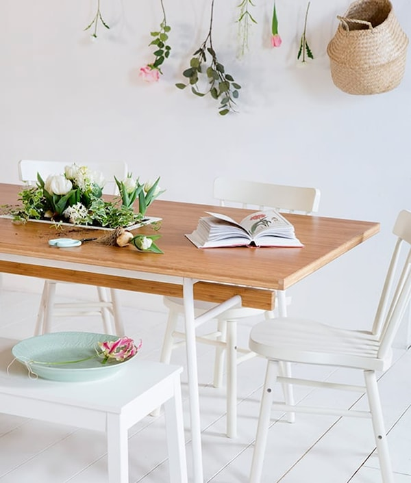 Dining room with a wooden dining table and white dining room chairs and dining room bench
