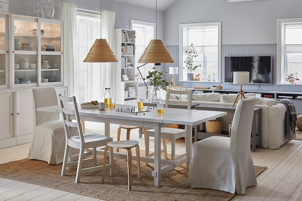 Dining room with white furniture.