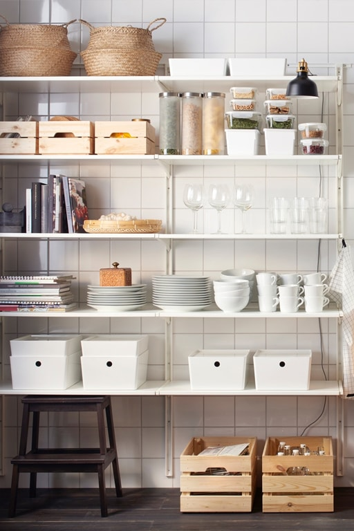 Dining wall storage with dishes organized.