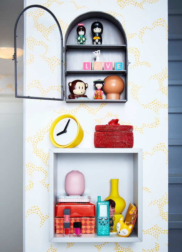 Display items you love in IKEA EKET square white open storage cabinet and BOLLEBYGD dark grey display box with three shelves and an arched glass door.