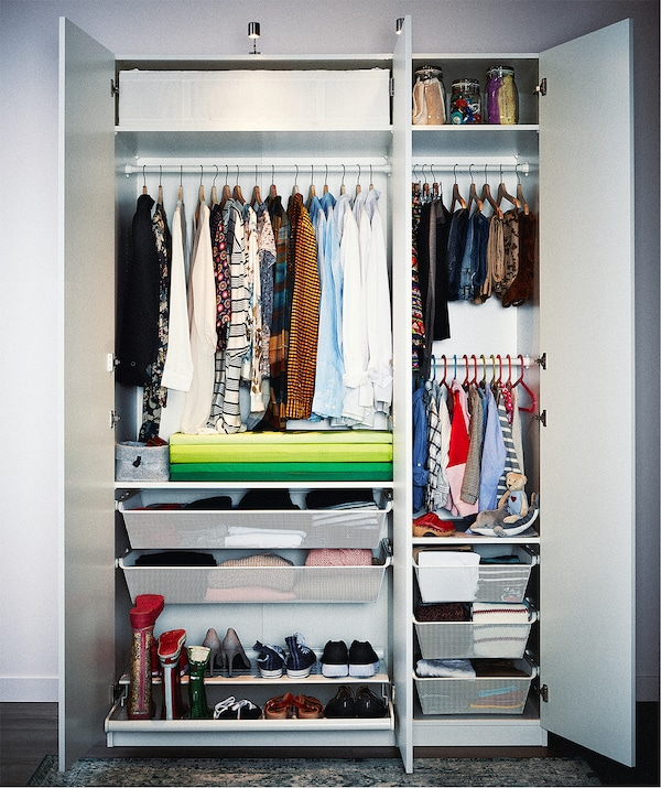 Double-plus-single cupboard wardrobe packed with highly organised clothing on hangers and shelves, in drawers and boxes.