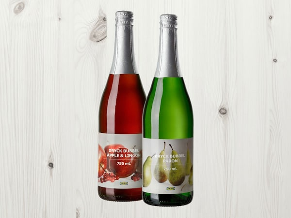 DRYCK BUBBEL ÄPPLE & LINGON and PÄRON sparkling drinks on a wooden background.