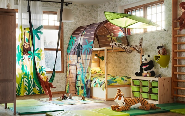 A children's room with stuffed animals and a bunk bed with a canopy