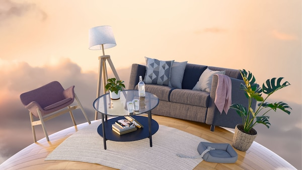 A living room with a sofa, armchair, and coffee table, placed on a small planet, floating in a sunset sky.