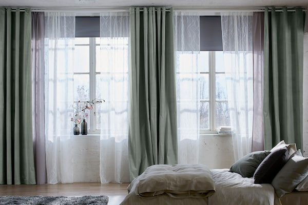 Large windows with curtains and block-out blinds.