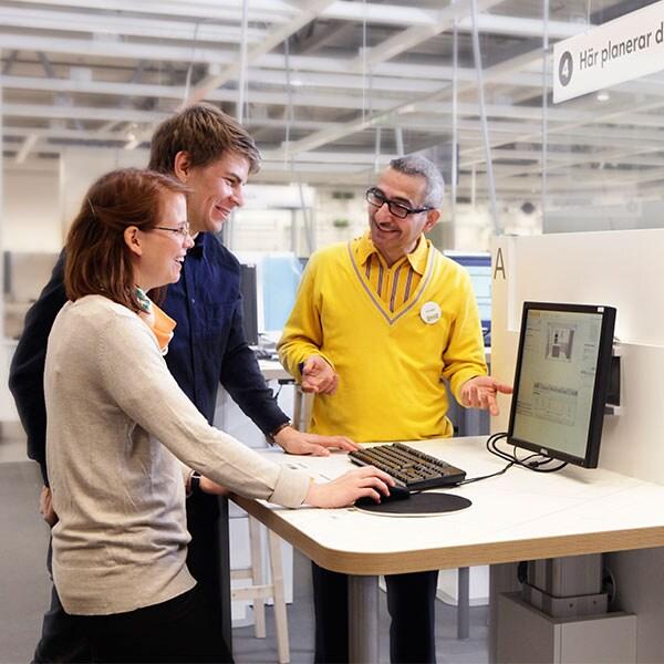An IKEA co-worker helping customers