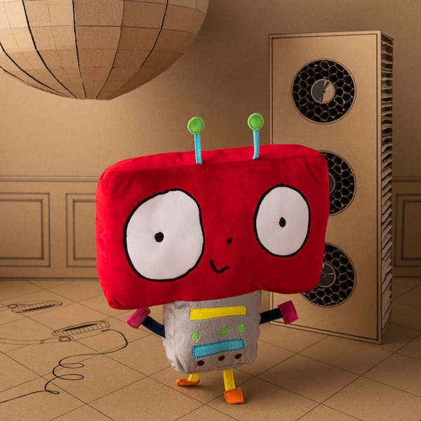 A smiling and dancing IKEA SAGOSKATT entertainer robot soft toy with a big red and square head with antennae.