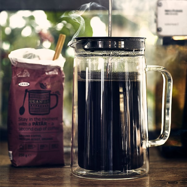EGENTLIG french press coffee maker next to a bag of IKEA coffee