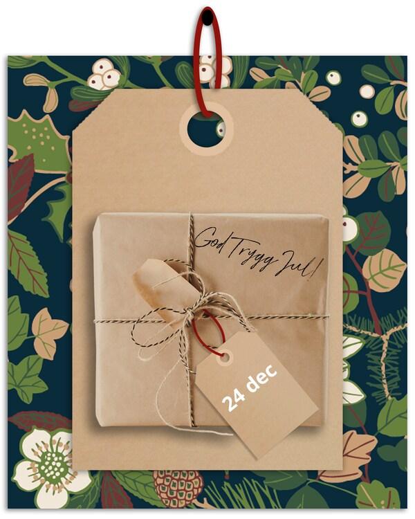 En brun hängetikett med rött band hänger framför en grön och blommönstrad bakgrund med god trygg jul skrivet på etiketten