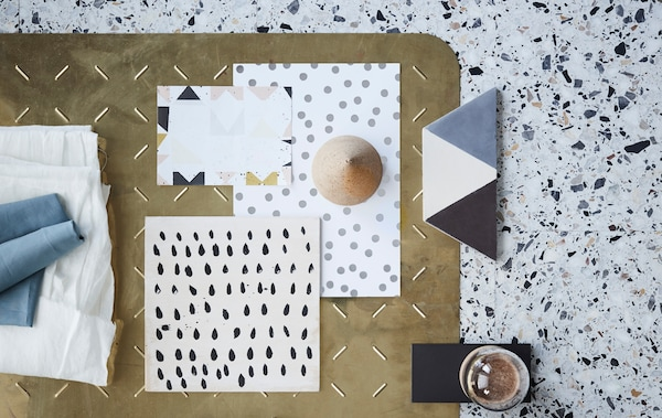 End-of-summer interior trends feature multiple examples of organic textures and graphic patterns. Here a mix of simple patterns with dots and blocks on paper and tiles, and notes of textiles, glass and brass.