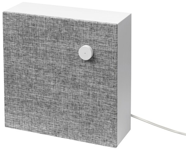 ENEBY Bluetooth speaker wall mounted against a gray painted wall.
