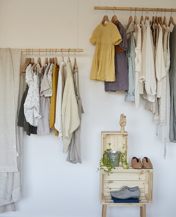 Eva and Marla's clothes stored on open rails.