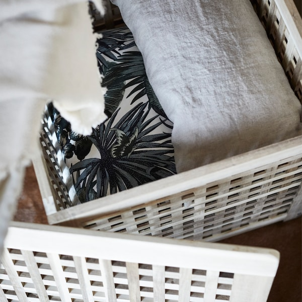 Every bedroom needs a few extra throws for comfort. Keep one like IKEA MATHEA close by.