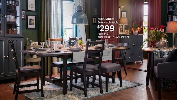 A Dining room with NORDVIKEN table and dark colored chairs surrounding it. NORDVIKEN extendable table, $349.