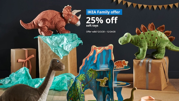 Several soft toy dinosaurs standing on top of gift boxes. IKEA Family offer 25% off soft toys, Offer valid 12/2/20 - 12/24/20