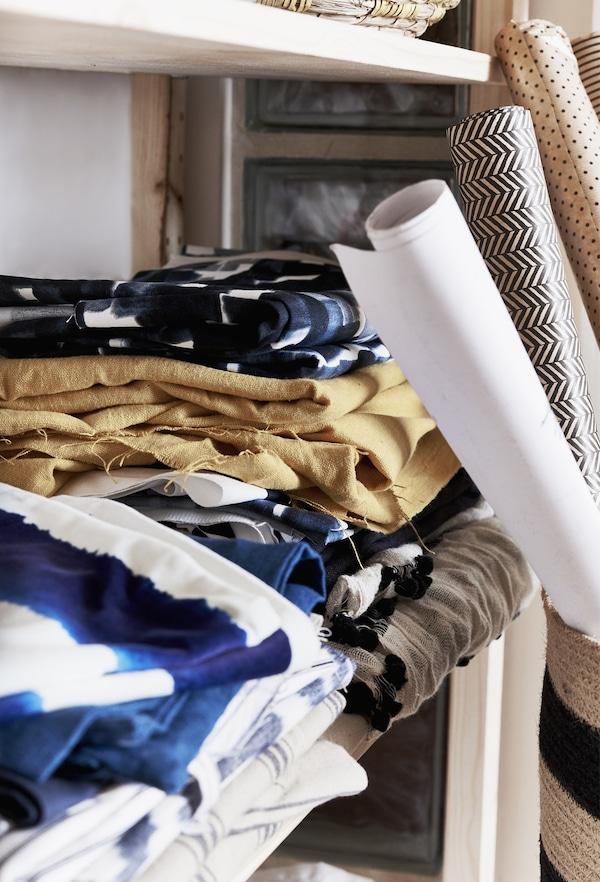 Fabric displayed on a shelf.