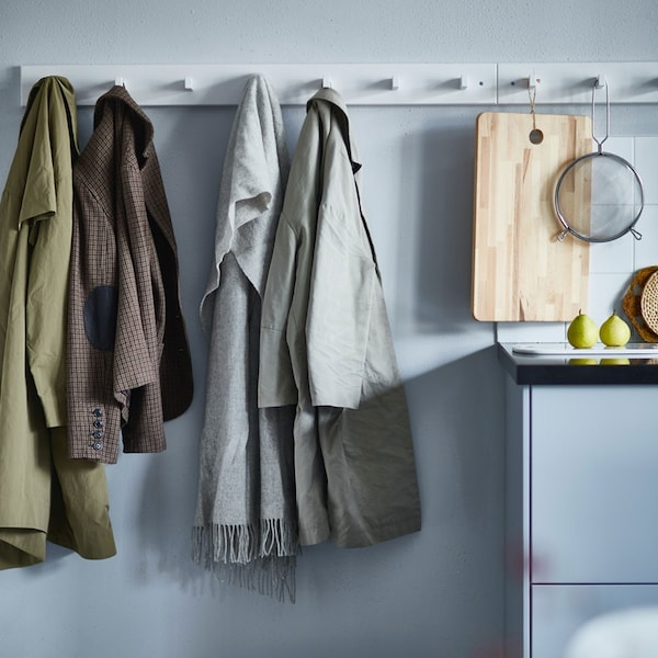 Fall coats hanging on a white KUBBIS wall rack