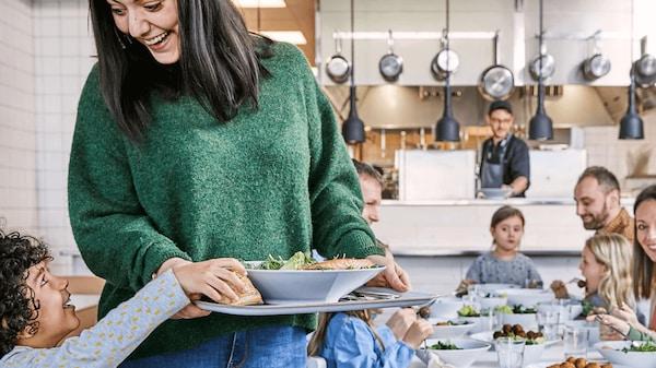 Family enjoying a meal in an IKEA Restaurant