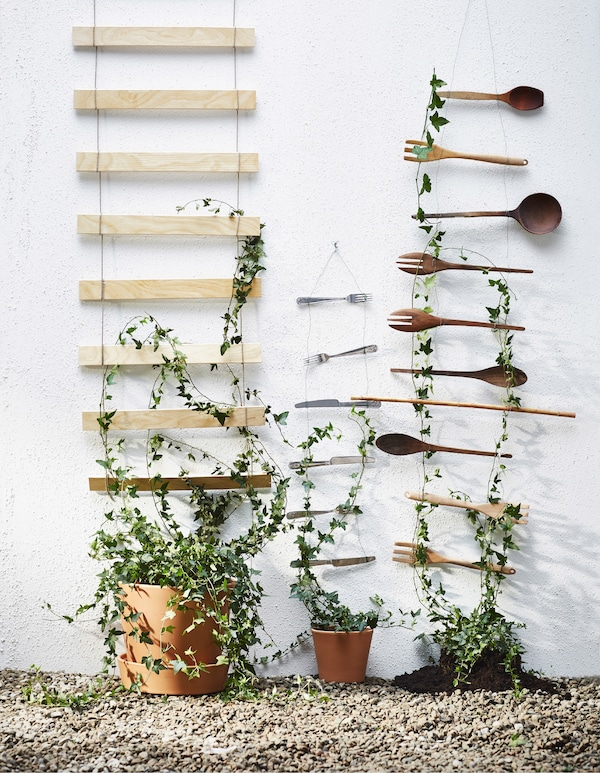 A DIY wall decoration made from bed slats and kitchen utensils.