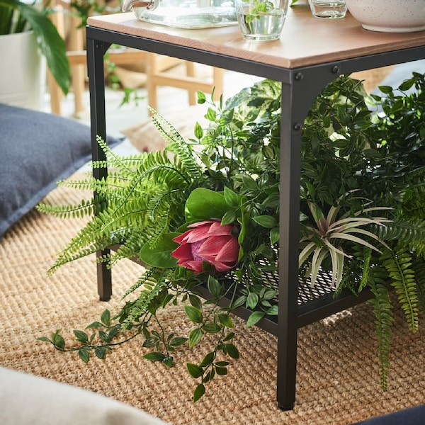 FEJKA plants are arranged inside a coffee table.