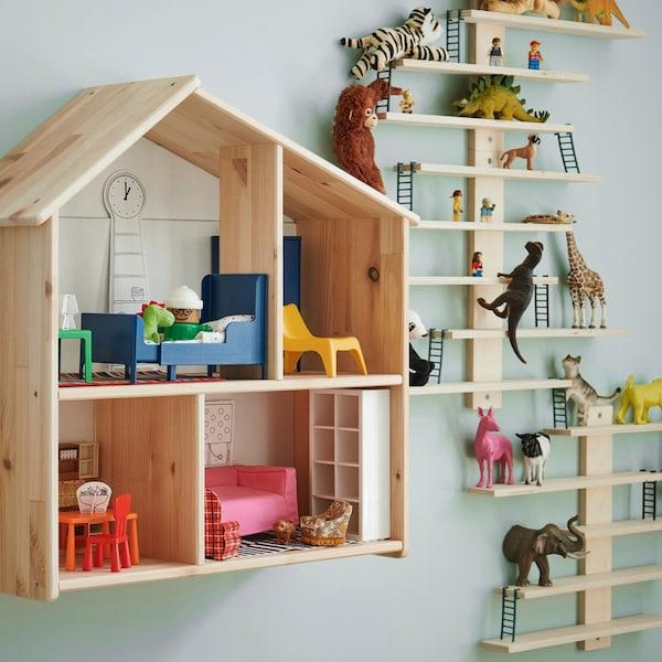 FLISAT doll house filled with toy furniture and LUSTIGT wall shelf filled with plastic dinosaurs and animals