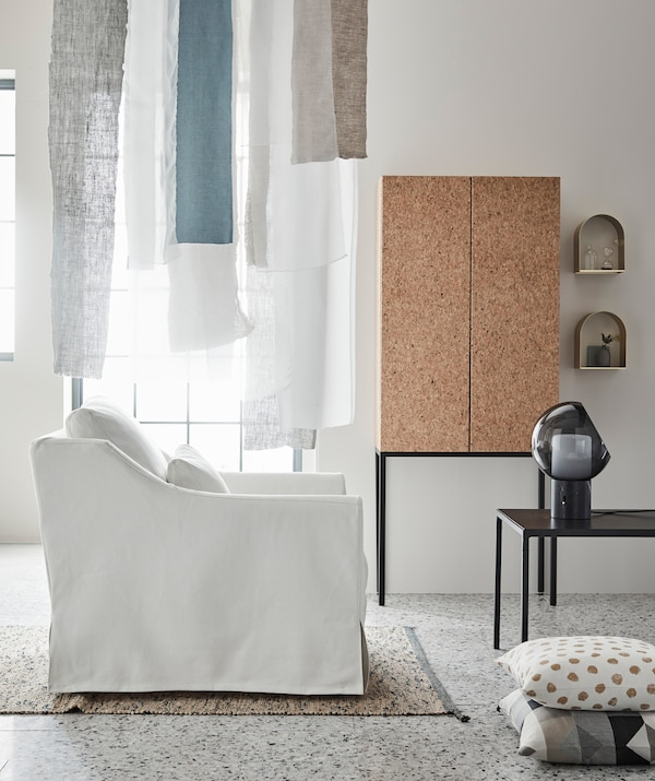 Flowing fabric. soft colours and thin-lined furniture assist daylight and space in giving the room a calm, airy feel.