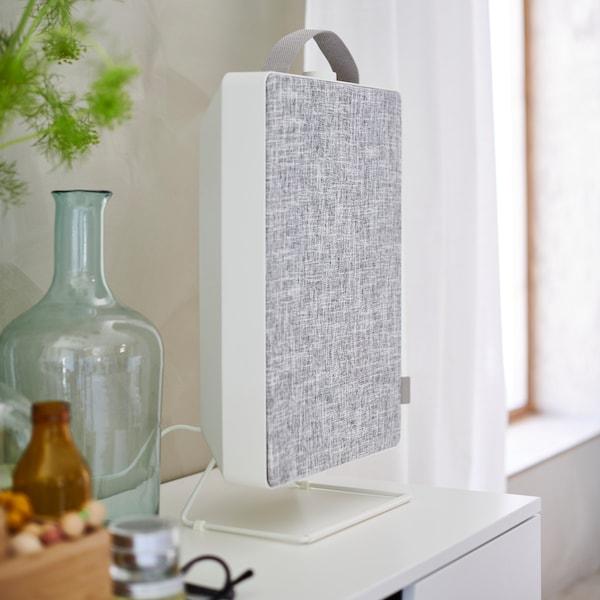 FÖRNUFTIG air purifier, sat on a chest of drawers.
