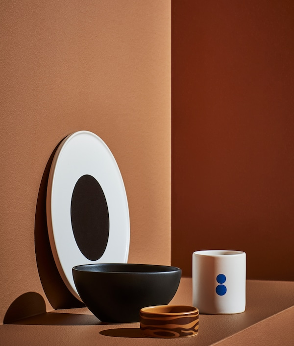 FÖRNYAD four-part service package, a large plate that looks like the eye of Darcel Disappoints, a white mug and two bowls.