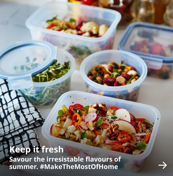 Food storage are seen on a countertop filled with bright and colourful summer food.