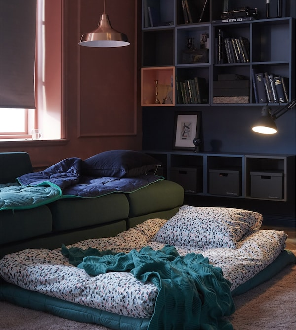 For a living room setup that's ready for friends who sleep over, think comfort.