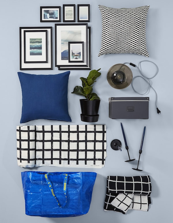 For black and white living room decor, IKEA has options like 100% cotton DVÄRGBJÖRK meter fabric in white and black. Its Scandinavian modern pattern has contemporary checks and mixes well with cushion covers, throws, table lamps, candlesticks and more.