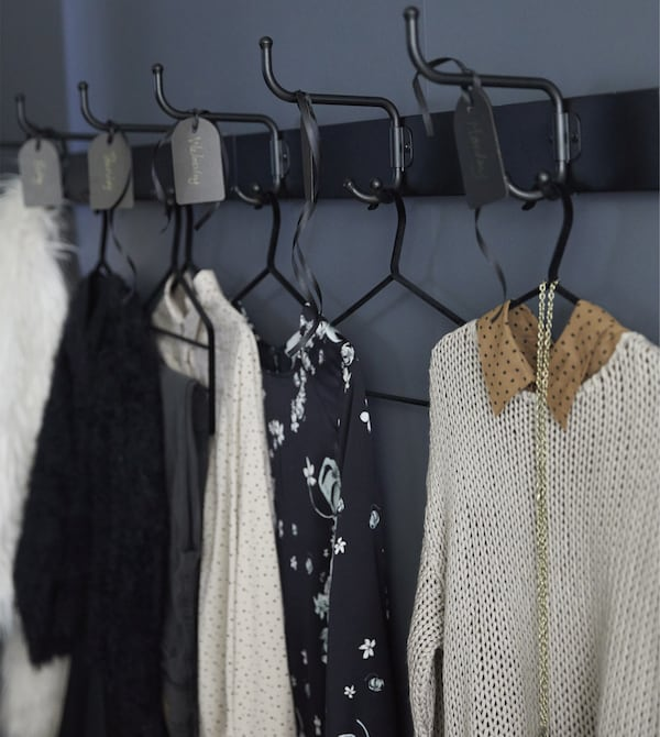 For clothes storage ideas, try racks like PINNING from IKEA. Put some beside your wardrobe to plan your outfits and save time in the morning. We put two black-coated steel racks with three-hooks each side-by-side for almost a week of prep.